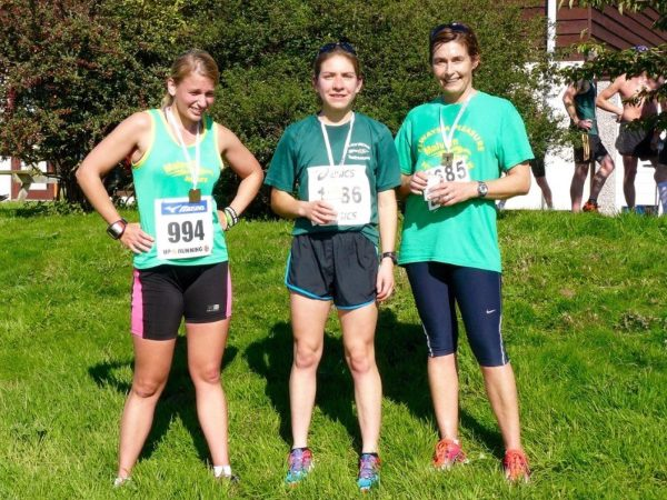 Three women dressed in running gear