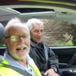 Two smiling men in a car