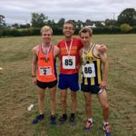 Three people in running gear