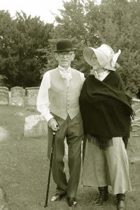 Sepia shot of man and woman in victorian costumer