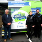 Two police officers, three men and a green van