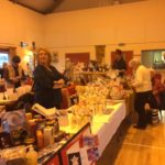 Stallholders and shoppers in the hall