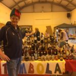 Tombola stall with man