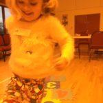 A little girl in a fluffy jumper
