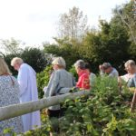 People standing in the allotments