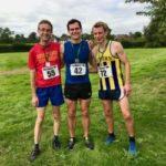 Three men in running gear