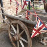 Wooden hand cart decorated with union jack bunting