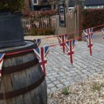 Union Jack bunting outside the entrance to the Moody Cow pub