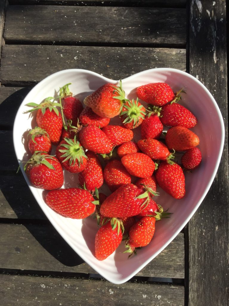 Fresh strawberries in a heart shaped bowl