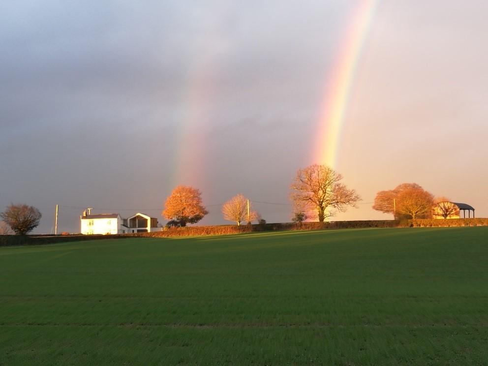 A double rainbow over a field