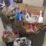 A selection of Christmas hampers containing food, drink and crackers