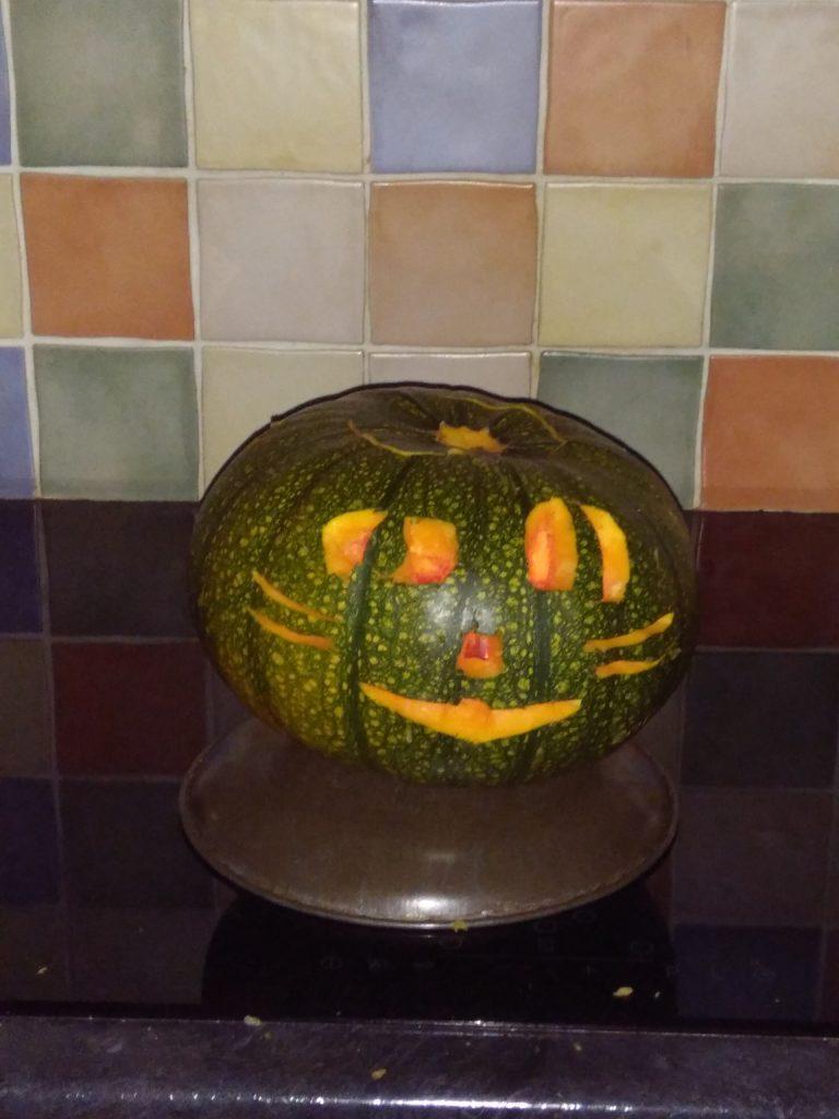 Carved pumpkin with light inside