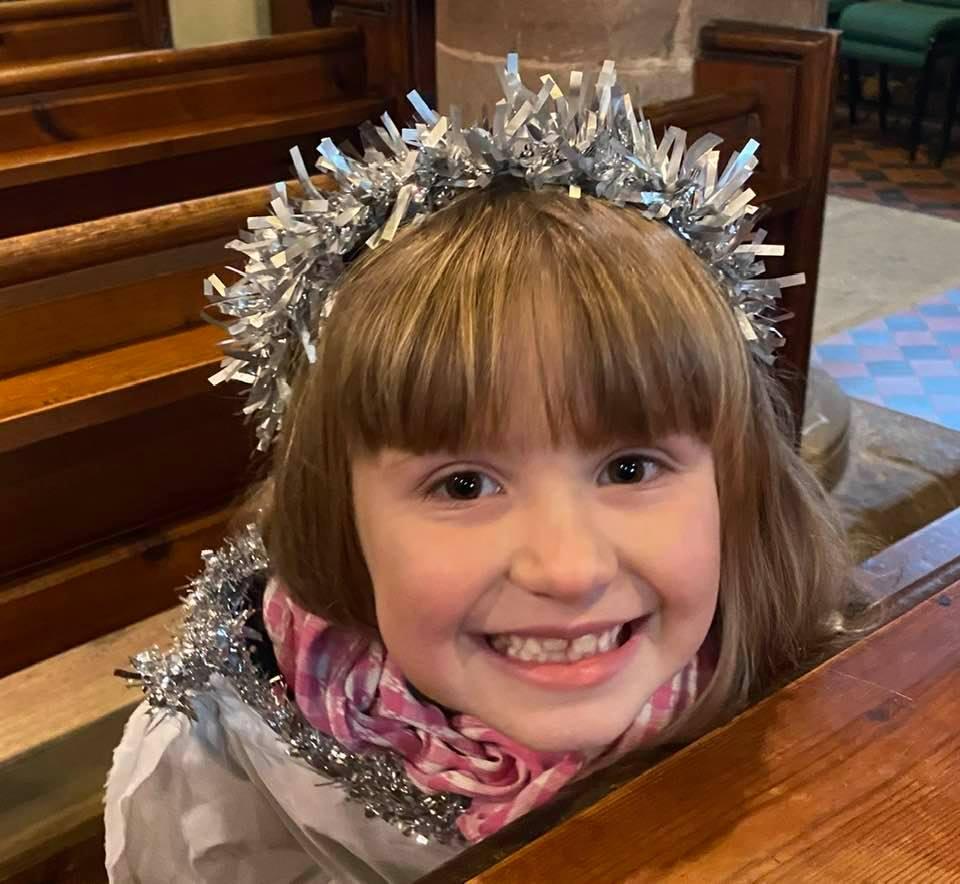 A little girl dressed as an angel