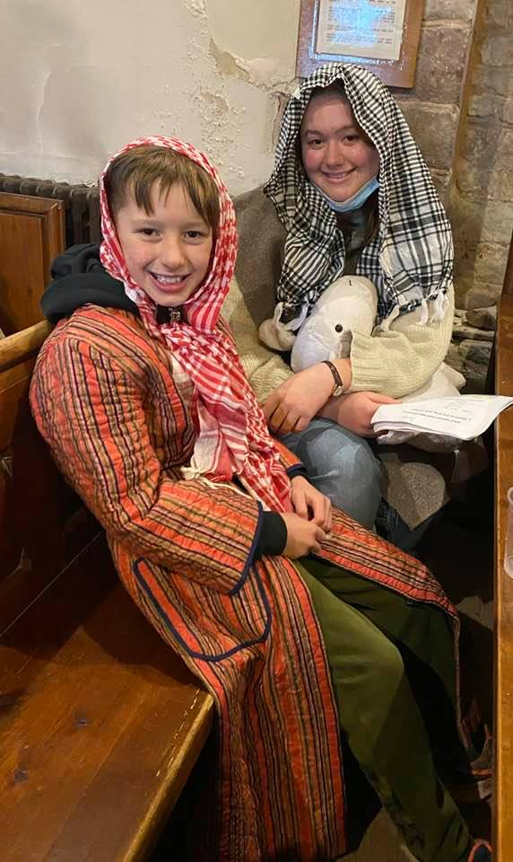 Two children dressed as shepherds