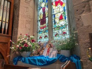 blue flowers and a stained glass window