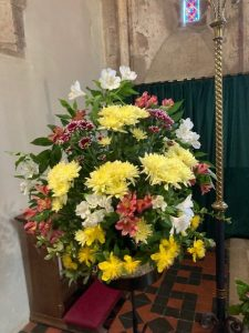 flowers arranged on a pedestal